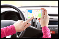 Female-driver-hand-holding-phone-interface-navigator-screen-39325725